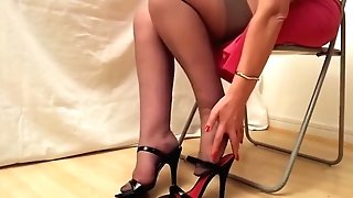 Black High-heeled Slippers And Rht Stockings